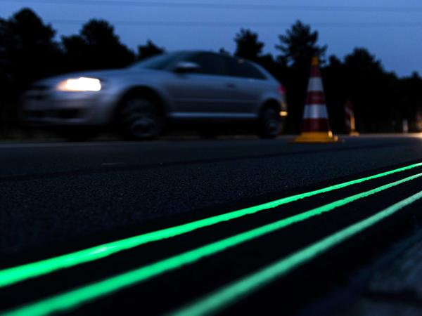 Glowing Lines are tested earlier this month on a highway near Oss in the Netherlands. The road markings absorb light during the day and emit the green glow at night.