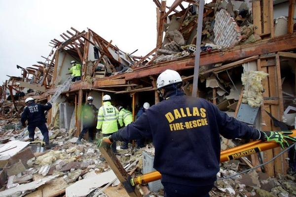 Firefighters search for survivors at a West, Texas, apartment building in April 2013. The breadth of destruction in West has raised questions about what, if any, new state laws should be passed to help prevent similar accidents in the future.