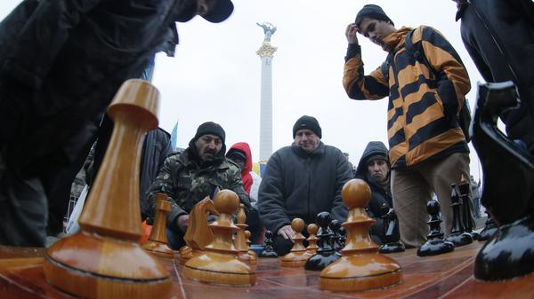 Protesters play chess in Independence Square in Kiev last winter. Some would say that Russian President Putin is playing geopolitical chess when it comes to Ukraine.