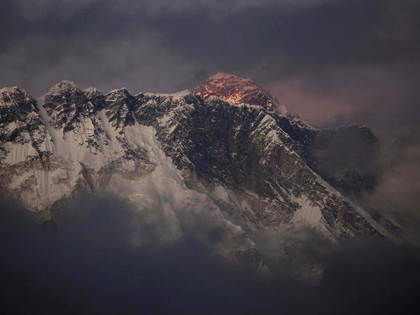 The sun shines on the peak of Mount Everest in this October 2011 photo. On Friday, an avalanche swept away 16 Sherpas.