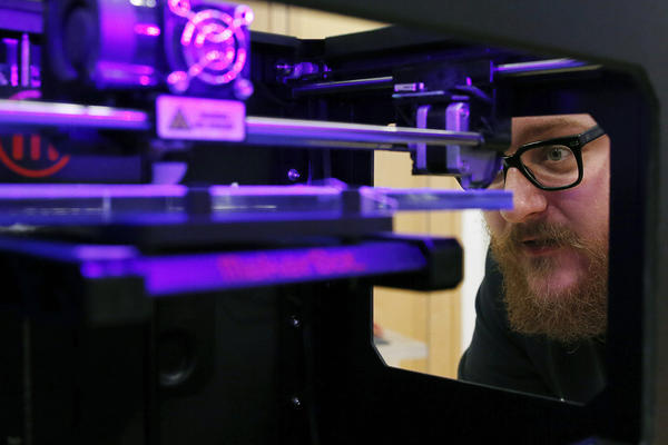 Andy Leer of maker space chain TechShop calibrates a 3-D printer at a GE-sponsored pop-up workshop in Washington, D.C. Maker spaces, which offer access to industrial-grade tools, are attracting support from governments and big companies like Ford and Lowe's.