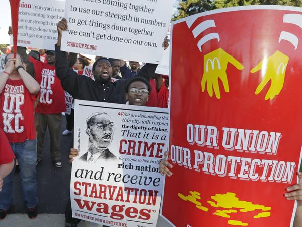 Hundreds of workers, organizers and supporters gather outside McDonald's Corp. on Thursday, in Oak Brook, Ill., calling for $15 an hour and the right to unionize.