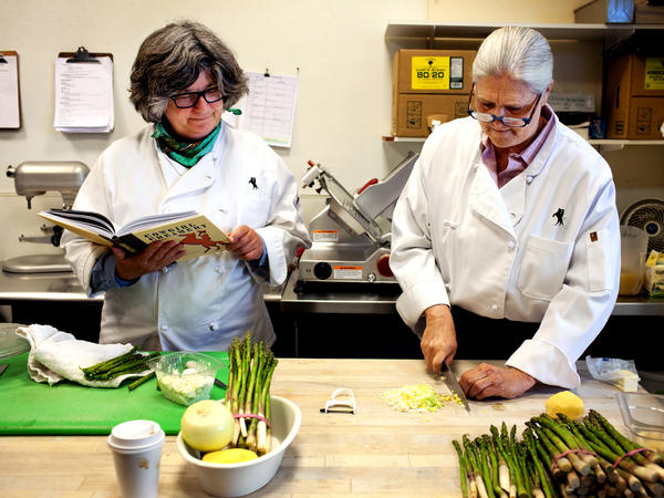 Sue Conley (left) and Peggy Smith, co-founders of Cowgirl Creamery, prepare their chilled leek and asparagus soup with creme fraiche and fresh ricotta at Cowgirl Creamery in Point Reyes Station, Calif.