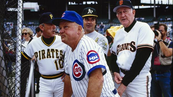 Don Zimmer, manager of the Chicago Cubs, watches batting practice before the 1990 All-Star game with fellow managers Jim Leyland of the Pittsburgh Pirates, Tony LaRussa of the Oakland Athletics and Roger Craig of the San Francisco Giants at Wrigley Field.