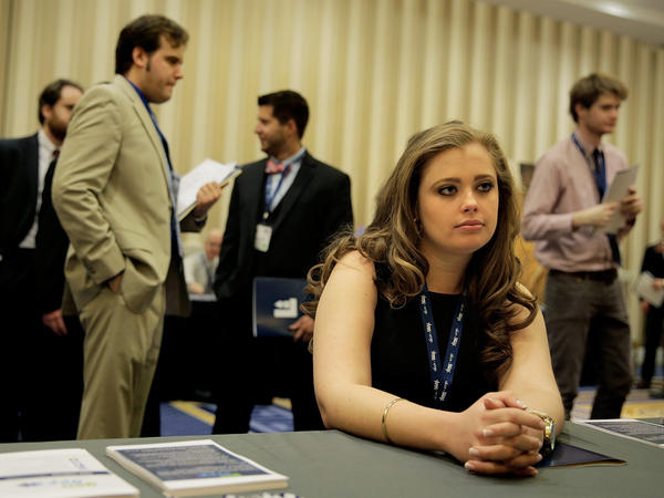 Kaitlin Foran, a senior at the College of Charleston in South Carolina, meets with a prospective employer at a job fair at National Harbor in Maryland.