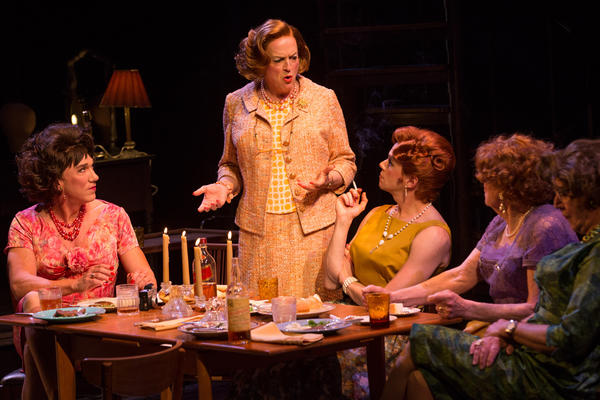 Wigs play an especially important role in the drama <em>Casa Valentina</em>. The play features Reed Birney (standing) as Charlotte, one of several male characters who spend their weekends dressing and living as women.
