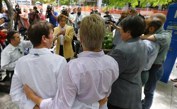 Peggy Tomsic (center), attorney for three same-sex couples, claps in celebration after the 10th Circuit Court in Denver rejected a same-sex marriage ban in Utah on Wednesday in Salt Lake City.