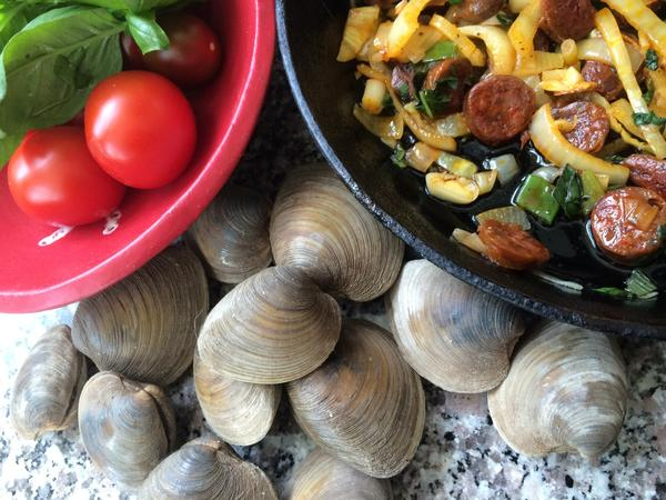 """Kathy Gunst's """"Roast Summer Clams with Chorizo, Tomatoes and Basil."""" See recipe below. (Kathy Gunst/Here & Now)"""