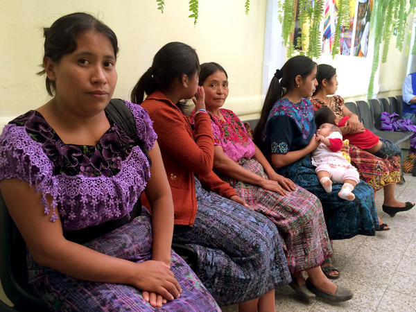 Guatemalan mothers wait at the Casa San Juan shelter in downtown Guatemala City. The government-run shelter receives children deported from the U.S. and Mexico.