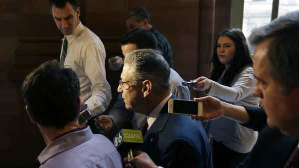 New York Assembly Speaker Sheldon Silver talks to reporters in a hallway at the capitol in Albany in March. The ranks of statehouse reporters have been thinning in recent years.