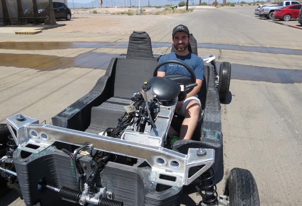 Local Motors engineer James Earl prepares to test drive the company's 3D printed vehicle prototype. (Carrie Jung/KJZZ)