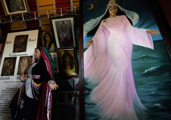 """An image of the Goddess """"Mother Yara"""" stands in a temple during an annual gathering celebrating the religious doctrine of the Vale do Amanhecer, near Brasilia, Brazil. The religious community, founded by the medium Tia Neiva, is linked to one of Brazil's many Spiritist movements."""