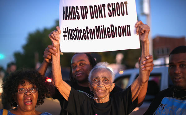 Creola McCalister, 88, protests the killing of teenager Michael Brown on Tuesday at a rally outside Greater St. Mark Family Church. Brown's death Saturday has sparked both peaceful rallies and violence this week.