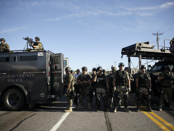 The police in Ferguson have been responding to the unrest with military-style weaponry. The images have drawn new attention from lawmakers who are concerned about the federal government's policy of giving military equipment to local police agencies with little requirements for training.