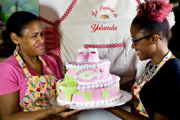 Yolanda Andujar and her daughter Astrid bake together every weekend. Andujar primarily makes the cakes while Astrid, a graphic designer by day, makes elaborate decorations using fondant and bright colors.