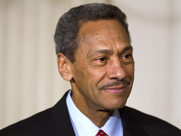 Mel Watt, director of the Federal Housing Finance Agency, says many homeowners who could qualify to refinance their mortgages under HARP are suspicious.