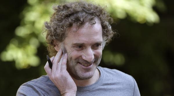 Peter Theo Curtis smiles as he talks with reporters outside his mother's home in Cambridge, Mass., on Wednesday.
