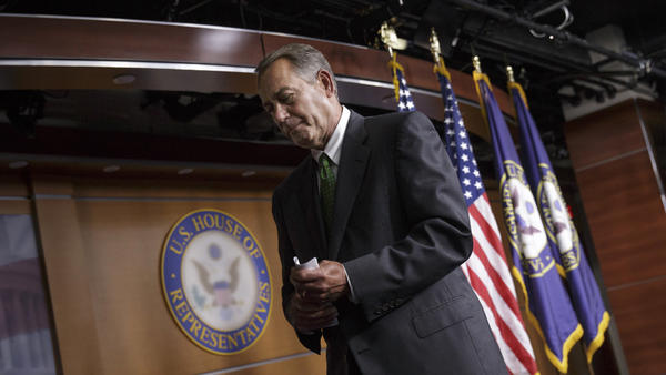 House Speaker John Boehner, R-Ohio, leaves after a news conference Thursday on Capitol Hill in Washington. Boehner responded positively to the proposals from President Obama about confronting Islamist militants in Iraq and Syria.