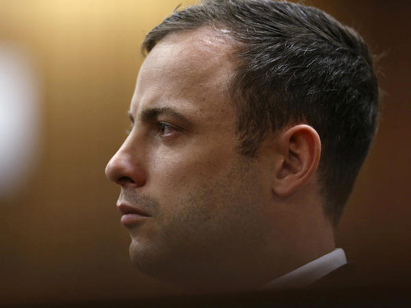 Olympic and Paralympic track star Oscar Pistorius listens to Judge Thokozile Masipa (unseen) deliver her verdict at the North Gauteng High Court in Pretoria on Friday.