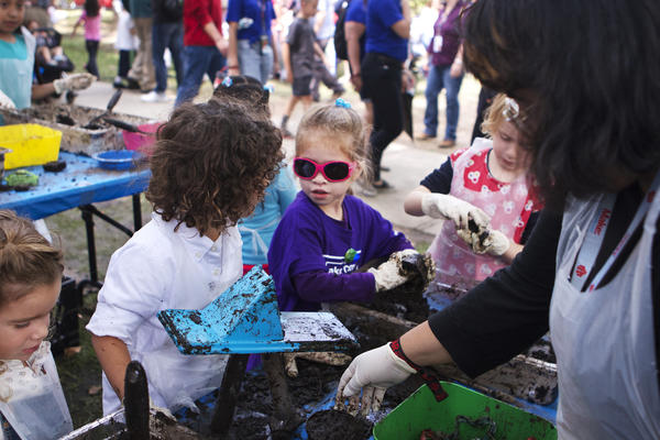 Not all projects were tech-based at World Maker Faire. Here, earth-based textile dyeing, aka sanctioned mud pies, is a hit.