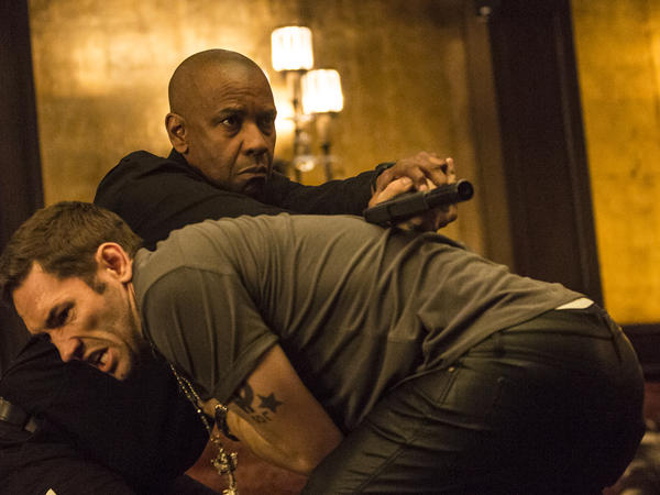 Denzel Washington stars as a retired intelligence officer in <em>The Equalizer</em>.