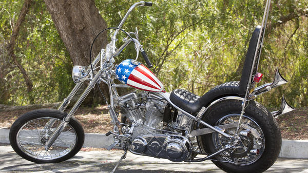 The Profiles In History auction house in Calabasas, Calif., is auctioning off the supposedly last authentic 'Captain America' chopper used in the film Easy Rider. The proceeds will go in part towards Michael Eisenberg, the current owner of the bike, as well as to the auction house and the American Humane Association.