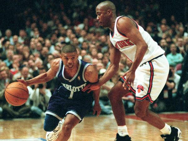 Charlotte Hornets guard Muggsy Bogues (works his way around New York Knicks guard Chris Childs in the first half of the NBA Eastern Conference playoffs on April 24, 1997.