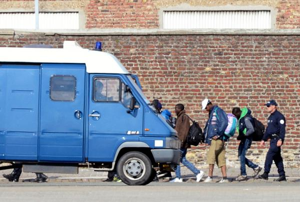 French policemen expel illegal migrants from their camp in Calais on July 2.