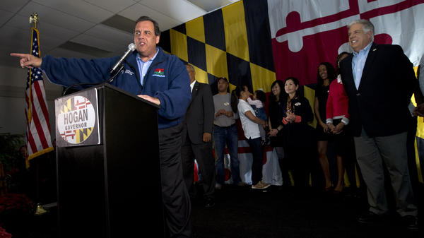 New Jersey Republican Gov. Chris Christie speaks during a campaign rally in support of Republican gubernatorial candidate Larry Hogan (right) in Baltimore.