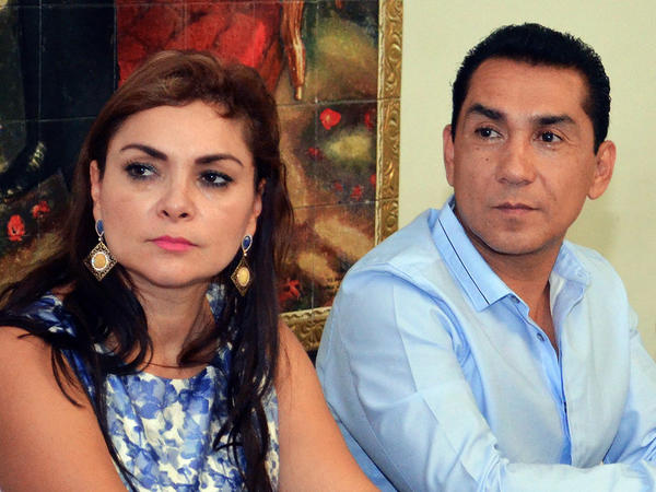 "Dubbed the ""imperial couple"" by a Mexican newspaper, the mayor of Iguala, Jose Luis Abarca, and his wife Maria de los Angeles Pineda were wanted for questioning in the case of the missing students and the mass graves found near Iguala. They are shown here in a photo taken in May."