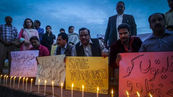 Pakistani activists and members of the Christian minority light candles to protest the killing of a Christian couple who were burned alive after being accused of blasphemy. The protest took place in the capital Islamabad on Wednesday.