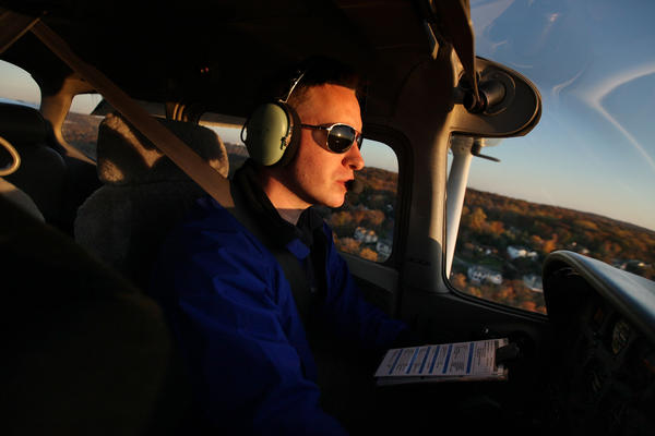Teacher Joshua Weinstein at the controls of a Cessna 172 Skyhawk above northern New Jersey. He says he had wanted to be a pilot since he was in first grade.
