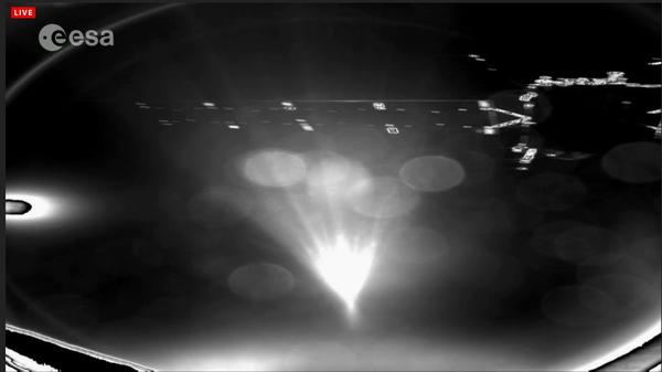The first image the ESA released from the Philae lander shows the craft breaking away from the Rosetta orbiter and heading toward 67P.