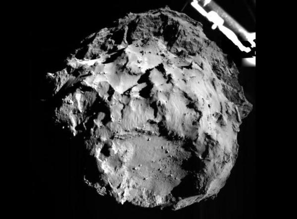 The Philae lander took this photo of its descent onto comet 67P Wednesday, when it was about 3 kilometers from the surface. The landing site is seen with a resolution of about 3 meters per pixel.