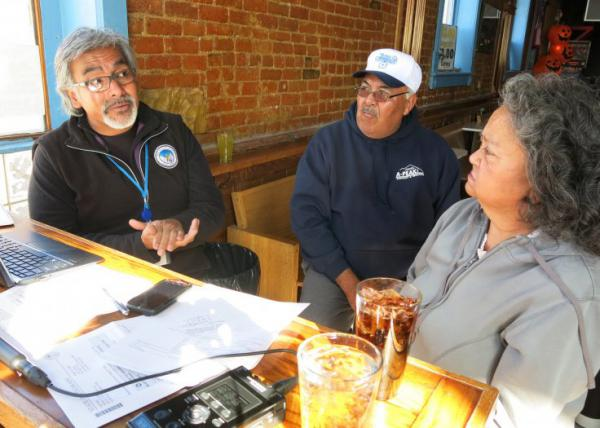 Lee Trujillo, a certified health coverage guide for Connect for Health Colorado in Leadville, discusses health insurance options with William and Helen Gallegos. (John Daley/CPR)