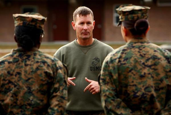 "1st Sgt. John Dober speaks to a group of Marines at Camp Lejeune. Dober, who served in combat in Iraq and Afghanistan, says the Marines owe the troops ""the best possible chance to bring them home alive."""