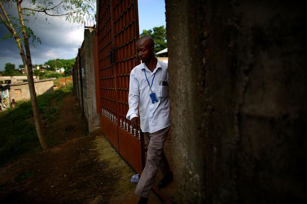 Osman leaves a health center in Freetown. The city does not have enough beds to treat Ebola patients.