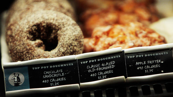 <strong>How many calories in that doughnut?</strong> A Starbucks coffee shop in New York City displays calorie information next to menu items. New FDA rules will require all chain restaurants and similar eating establishments to post calorie labels.