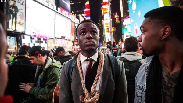 People protest Tuesday night in New York City's Times Square regarding the grand jury decision to not indict officer Darren Wilson in the Michael Brown case in Ferguson, Mo.