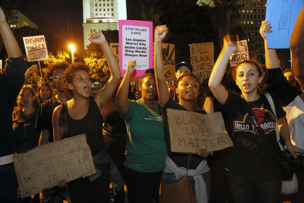 People gather outside the Los Angeles Police Department headquarters on Tuesday.