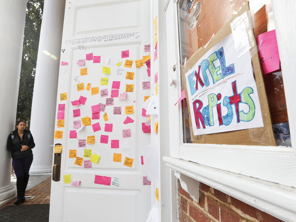 A University of Virginia student looks over postings on the door of Peabody Hall related to the Phi Kappa Psi gang rape allegations at the school in Charlottesville, Va., Monday, Nov. 24, 2014.