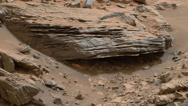 "NASA says ""cross-bedding"" in the layers of this Martian rock is proof that water moved on Mars, leaving waves or ripples of loose sediment. The image is from a site at Mount Sharp that NASA calls ""Whale Rock."""