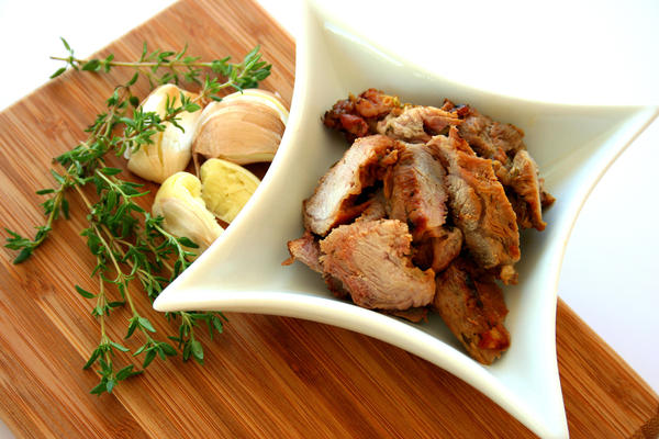 Garlic pork comes from the Portuguese culinary tradition. It involves a preparation that seems to fly in the face of food-safety common sense: The meat sits out at room temperature for weeks in a vinegar bath.