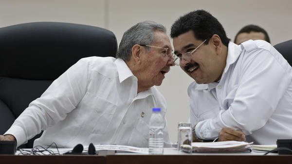 Venezuelan President Nicolas Maduro (right), shown at a summit in Cuba in October, and Cuban President Raul Castro are close allies. Both have been highly critical of the U.S., but Cuba and the U.S. announced they now plan to normalize relations. Venezuela, meanwhile, was already facing serious economic problems before the price of oil, its main export, fell sharply.