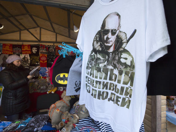 """A T-shirt bearing the image of Russian President Vladimir Putin reads """"The most polite man"""" at a St. Petersburg market in Russia on Wednesday. Putin began the year in dramatic fashion by hosting the Winter Olympics and seizing Crimea. His year ended, however, with Russia's economy in turmoil and forecasts of a recession for 2015."""