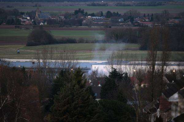 Smoke rises from a building in Dammartin-en-Goele, northeast of Paris, where two brothers suspected in the attack on the offices of <em>Charlie Hebdo </em>were cornered by police. The suspects, Said and Chérif Kouachi, were killed.