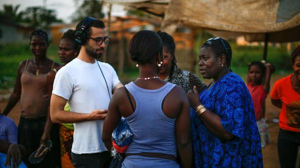 NPR reporters Sami Yenigun and Ofeibea Quist-Arcton at work in Liberia in December.