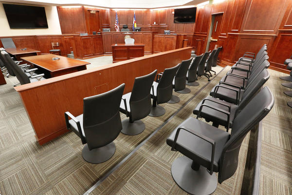 A view of the jury box, right, inside Courtroom 201, where jury selection in the trial of Aurora movie theater shootings defendant James Holmes is to begin Tuesday at the Arapahoe County District Court in Centennial, Colo.