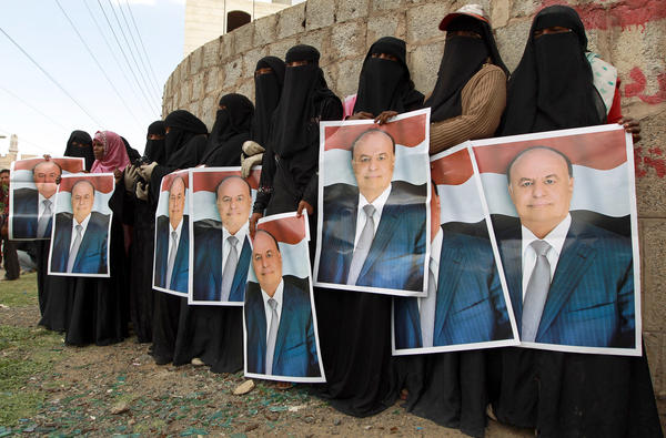 Female demonstrators hold up posters of Yemen's president during an August pro-government demonstration in Sanaa. The rebels took over the presidential palace on Tuesday.