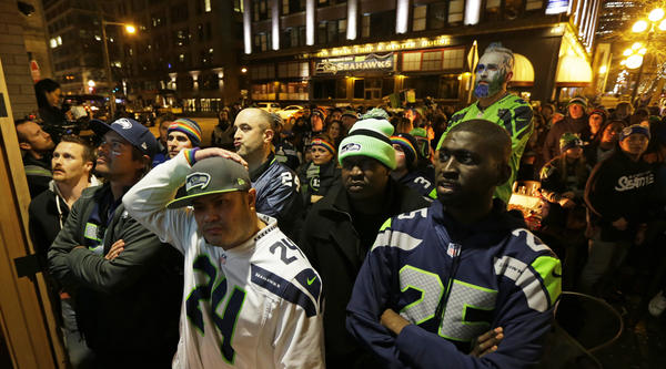 Dejected Seahawks fans watch Super Bowl XLIX in Seattle on Sunday. The New England Patriots defeated the Seahawks 28-24.